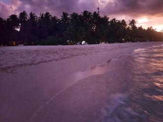 Fihalhohi Island resort at sunset