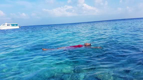 floating on Indian Ocean Fihalhohi Island Resort